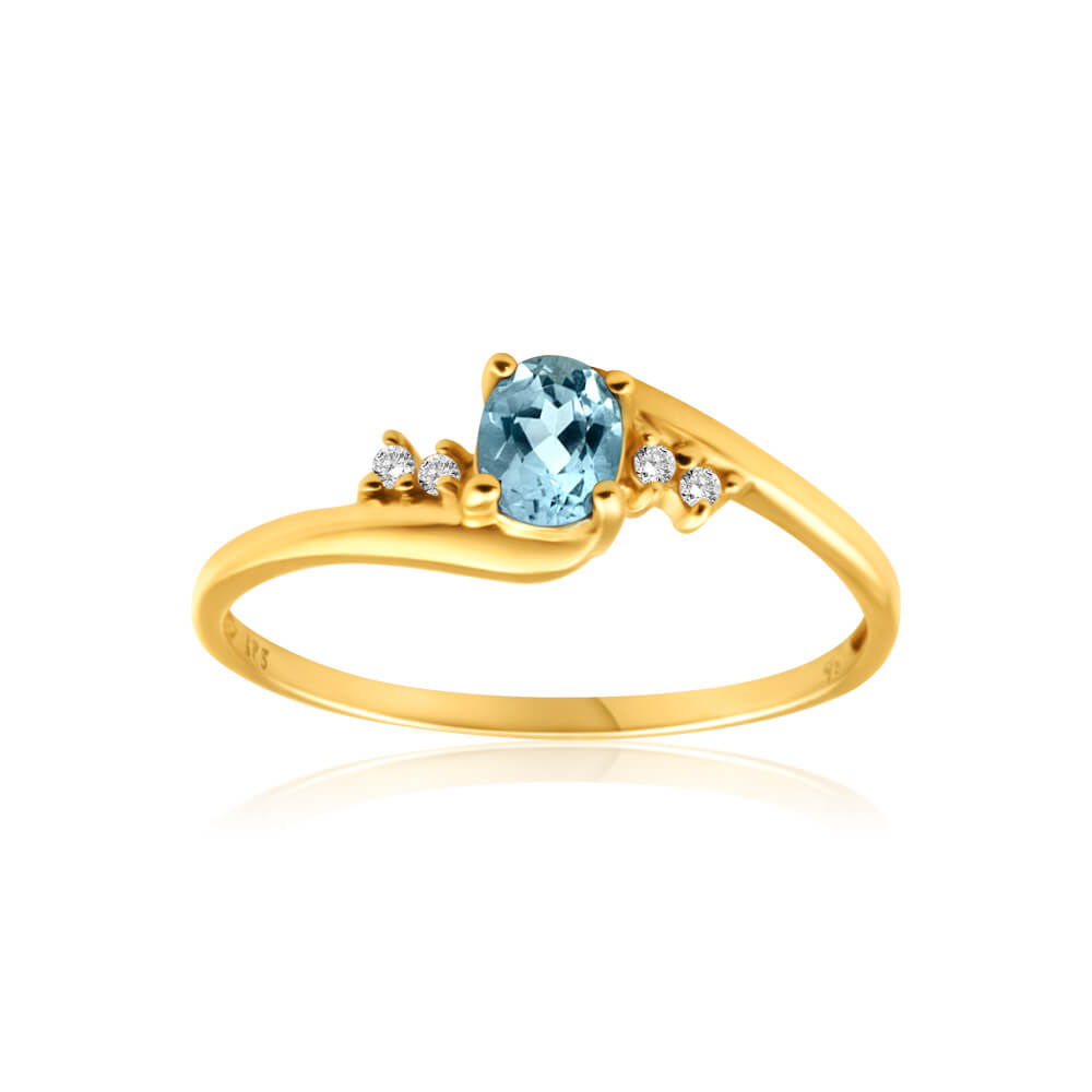 9ct Yellow Gold Blue Topaz + 4 Cubic Zirconia Ring
