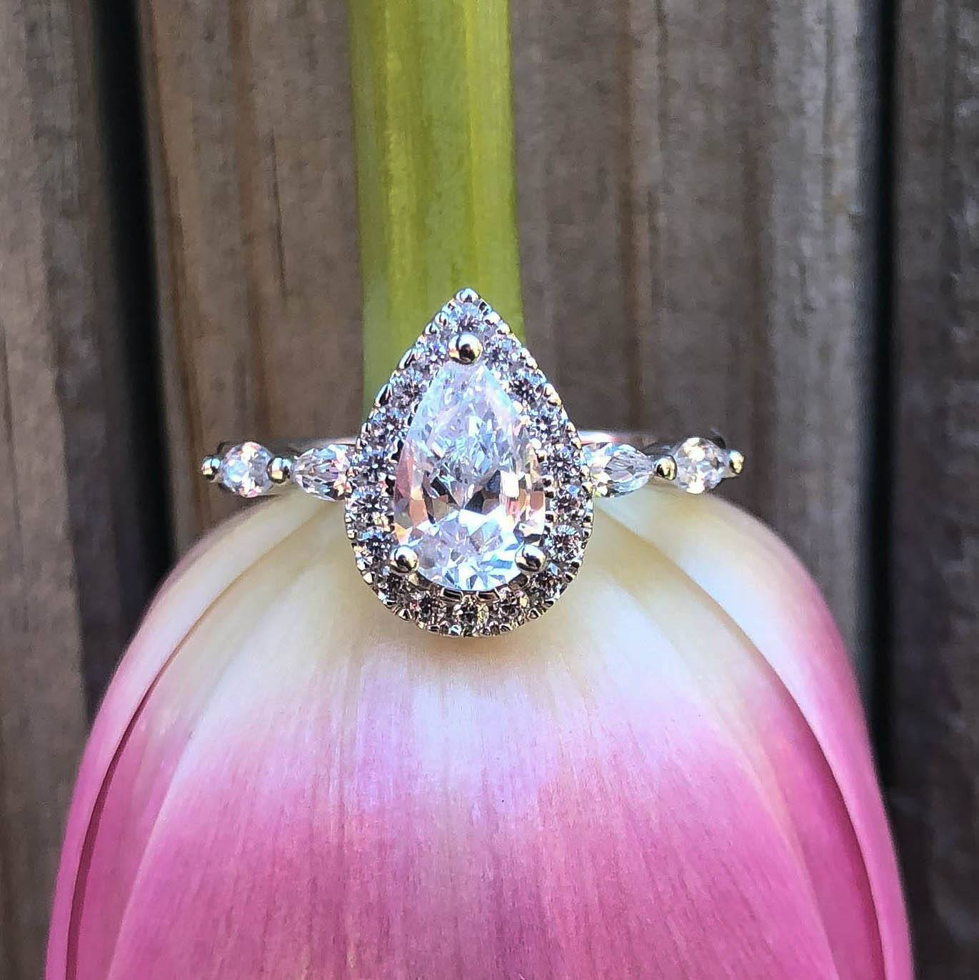 Sterling Silver Rhodium Plated Cubic Zirconia Pear Halo Ring with Marquise Band